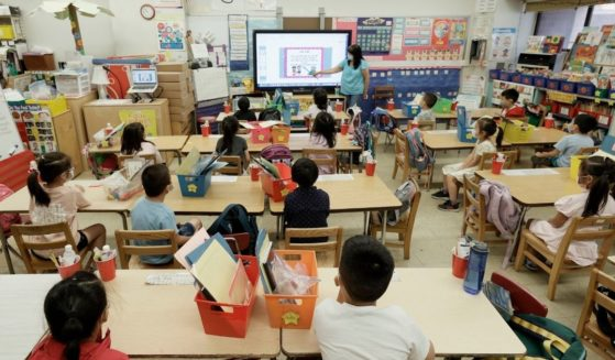 A teacher at Yung Wing P.S. 124 is seen teaching students on July 22, 2021, in New York City.