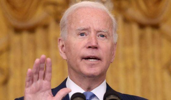 President Joe Biden speaks from the East Room of the White House in Washington on Thursday.