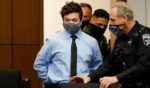 Kyle Rittenhouse, charged in the shooting deaths of two men and wounding a third during riots in Kenosha, Wisconsin, in August 2020, is pictured in a file photo from October of that year entering a courtroom.
