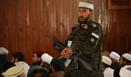 A Taliban fighter stands guard Friday during prayers at a Kabul, Afghanistan, mosque.