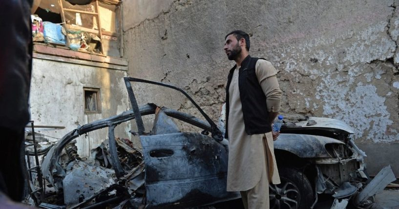 A brother of slain aid worker Ezmarai Ahmadi stands next to the wreckage of a vehicle that was damaged in the Aug. 29 Americandrone strike Afghanistanthat killed Ahmadi, along with two other adults and seven children.