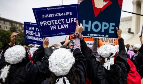 Supporters of Judge Amy Coney Barrett drown out pro-abortion demonstrators outside the U.S. Supreme Court in an Oct. 12, 2020 file photo.