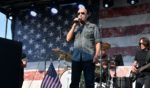 """Singer Lee Greenwood performs on stage during a Sept. 10 """"Helping A Hero"""" concert and presentation in Hendersonville, Tennessee, for veterans and their familes."""
