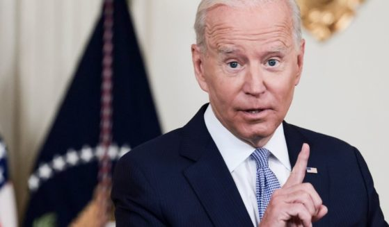 President Joe Biden gestures during remarks Friday at the White House.