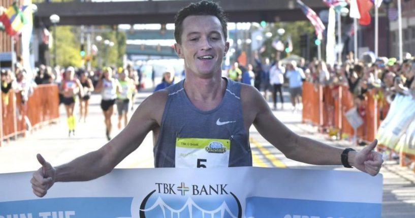 Tyler Pence is seen crossing the finish line at the TBK Bank Quad Cities Marathon in Moline, Illinois, on Sunday.