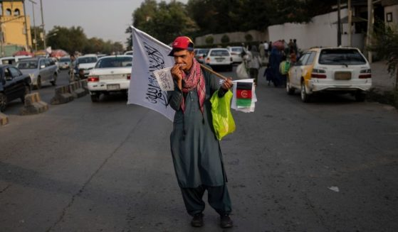 A street vendor is seen selling Taliban and Afghan flags in Kabul, Afghanistan, on Thursday.