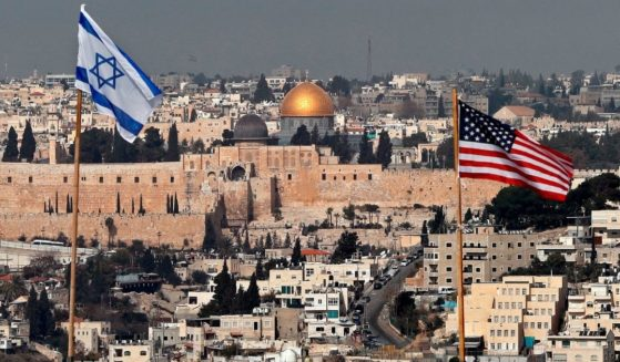 A photo shows the Israeli and US flags standing side by side in East Jerusalem on Dec. 13, 2017.