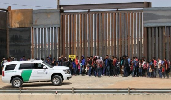 Central American migrants are detained by U.S. Customs and Border Patrol agents at the border wall in Ciudad Juarez, Chihuahua state, Mexico, on May 7, 2019.