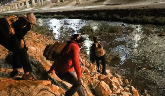 Haitian migrants illegally cross the Rio Bravo in an attempt to get from Ciudad Juarez, in the Mexican state of Chihuahua, to El Paso, Texas, on March 30.