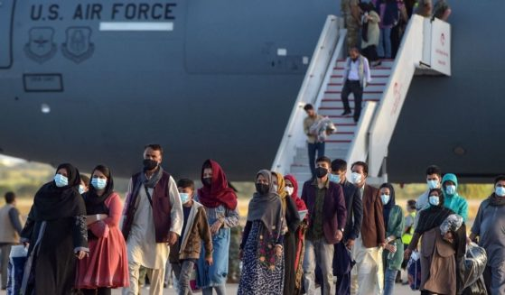 Refugees disembark from a U.S. Air Force aircraft after an evacuation flight from Kabul at the Rota naval base in Rota, southern Spain, on Aug. 3.