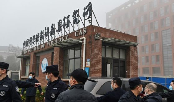 Members of the World Health Organization team investigating the origins of COVID-19 arrive at the Wuhan Institute of Virology in China's central Hubei province on Feb. 3.