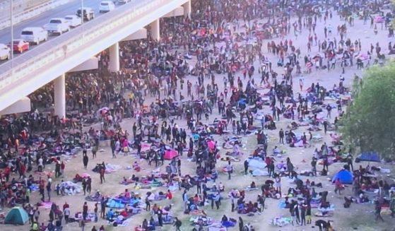 Migrants gather under the Del Rio International Bridge in Del Rio, Texas, on Thursday.