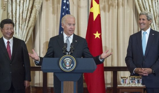 U.S. President Joe Biden, center, Chinese President Xi Jinping, left, and Secretary of State John Kerry are seen at a State Luncheon for China at the Department of State in Washington, D.C., on Sept. 25, 2015.