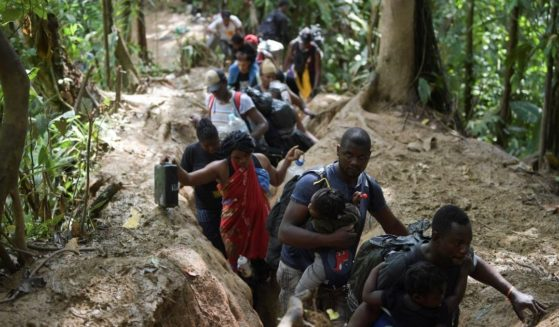 Haitian migrants cross the jungle of the Darien Gap, near Acandi, Choco department, Colombia, heading to Panama, on Sunday on their way trying to reach the U.S.