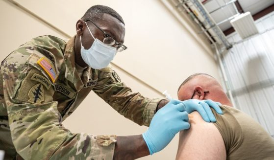 Preventative Medicine Services NCOIC Sergeant First Class Demetrius Roberson administers a COVID-19 vaccine to a soldier on Sept. 9, in Fort Knox, Kentucky.
