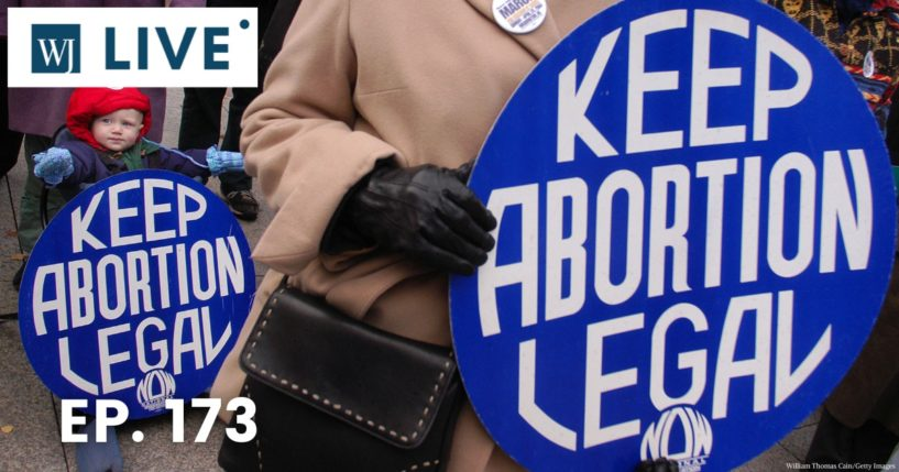 Pro-abortion activists are seen at a protest in the image above.