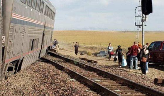 Survivors congregate near the scene of an Amtrak derailment in Montana on Saturday.