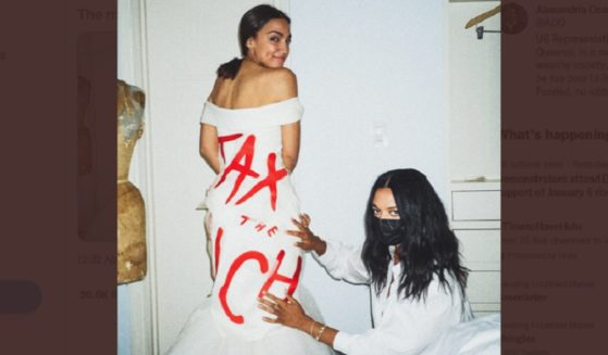 "U.S. Rep. Alexandria Ocasosio-Cortez with ""tax the rich"" dress designer Aurora James."