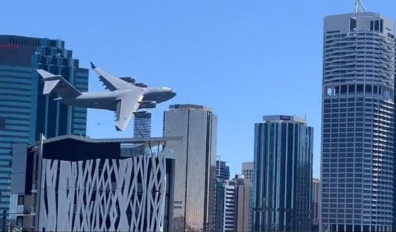 An Australian Air Force C-17 cargo plane demonstrates how nimble the large jet can be during maneuvers over Brisbane, Australia.