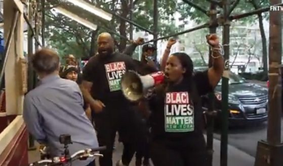 Black Lives Matter activists protest outside a New York City restaurant on Monday.