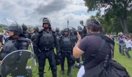 """Capitol Police in riot gear photographed a """"Justice for J6"""" rally Saturday."""