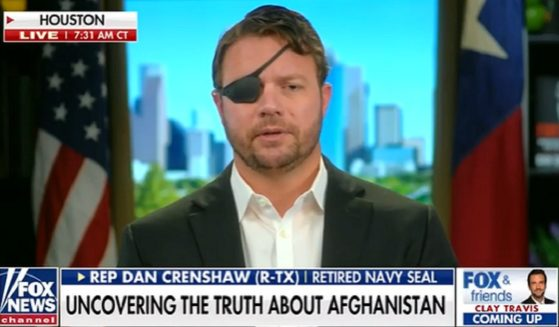 "U.S. Rep. Dan Crenshaw is interviewed on ""Fox & Friends"" on Wednesday."