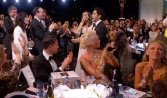 A crowd applauds at Sunday's Emmys, without a mask to be seen.