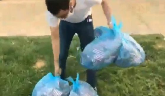 A student at Washington University in St. Louis was captured on video gathering American flags meant for a 9/11 memorial and placing them in trash bags.