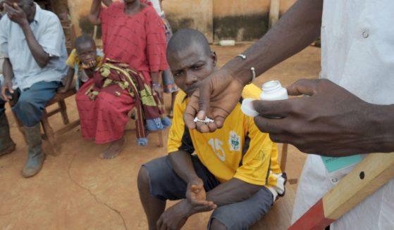 A nurse distributes ivermectin on Sept. 27, 2008, in Kouadioa-Allaikro, Ivory Coast.