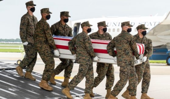 A group of Marines transfers the remains of Marine Corps Cpl. Daegan W. Page of Omaha, Nebraska, on Aug. 29, 2021, at Dover Air Force Base, Delaware.