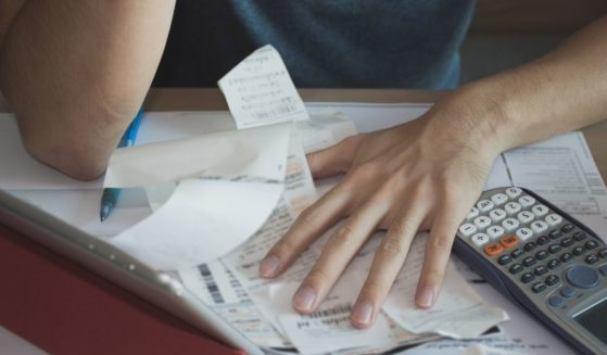 A man pores over his finances in this stock image.