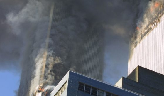 The twin towers of the World Trade Center burn on Sept. 11, 2001.