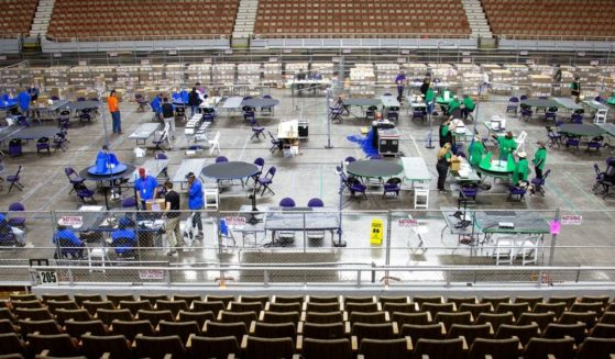 Contractors working for Cyber Ninjas examine and recount ballots from the 2020 general election at Veterans Memorial Coliseum on May 1, 2021, in Phoenix.