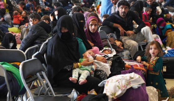 Groups of Afghan refugees wait to be processed on Ramstein Air Base, Germany, on Sept. 8.