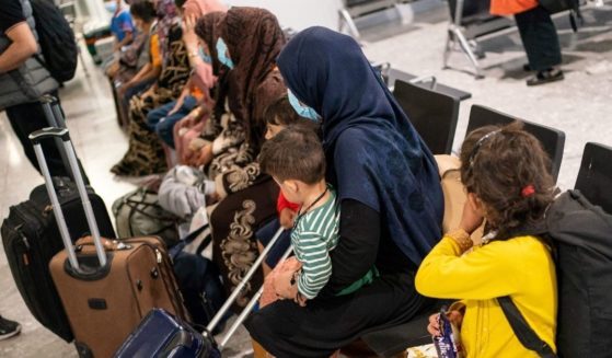 Refugees wait to be processed after arriving on an evacuation flight from Afghanistan at Heathrow Airport in London on Aug. 26.