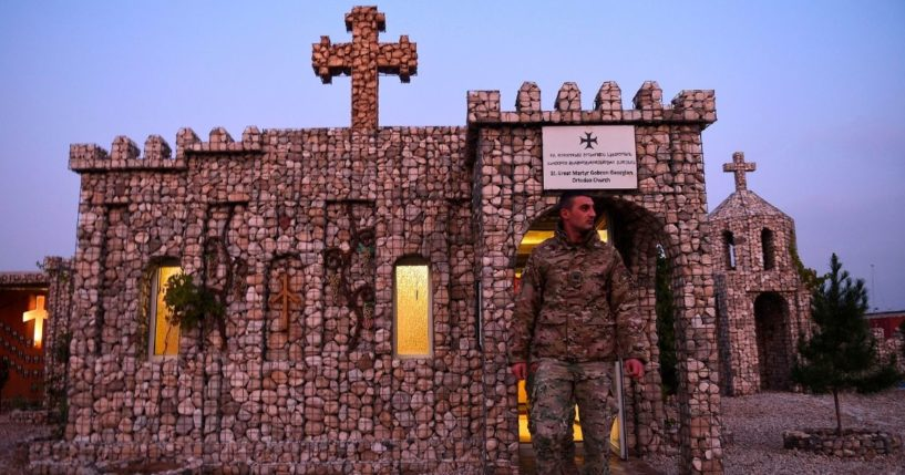 In this photograph taken on Nov. 27, 2019, a Georgian soldier leaves a church after praying at the NATO military base Camp Marmal on the outskirts of Mazar-i-Sharif, Afghanistan.