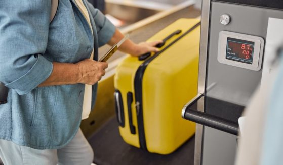 This stock photo shows a woman weighing her bag at the airport. Jared and Kristi Owens realized their bags were overweight when checking in at the Lubbock airport in Texas.