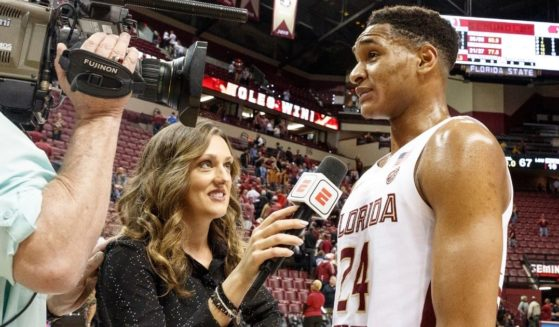 Allison Williams is seen interviewing Devin Vassell of the Florida State Seminoles in this file photo from February 2020. Williams left ESPN last week over the media company's vaccine mandate. Now she has been hired to do a sports show for The Daily Wire.