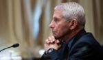 Dr. Anthony Fauci, director of the National Institute of Allergy and Infectious Diseases, listens during a Senate Appropriations Subcommittee looking into the budget estimates for National Institute of Health (NIH) and the state of medical research on May 26 on Capitol Hill in Washington.