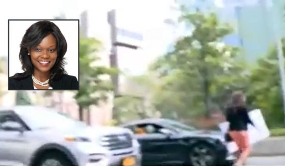 New York state Assemblywoman Rodneyse Bichotte Hermelyn, inset, walks into traffic to avoid NY1 reporter Courtney Gross.