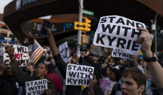 Protesters rallying against COVID-19 vaccination mandates and in support of basketball player Kyrie Irving gather in the street outside the Barclays Center before an NBA basketball game between the Brooklyn Nets and the Charlotte Hornets, Sunday, Oct. 24, 2021, in New York.