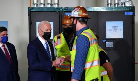 President Joe Biden tours the Clayco construction site in Elk Grove Village, Illinois, on Oct. 7, 2021.