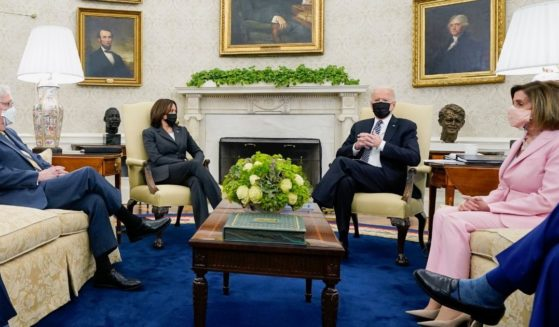From left to right, Senate Minority Leader Mitch McConnell, Vice President Kamala Harris, President Joe Biden, and House Speaker Nancy Pelosi meet in the Oval Office on May 12.