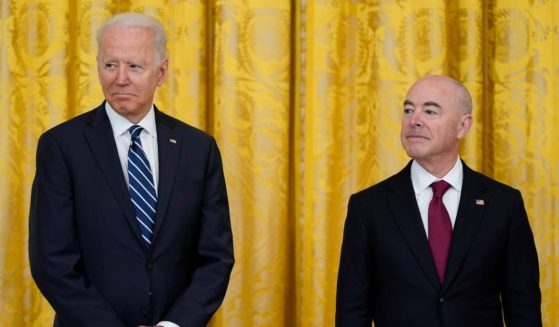 President Joe Biden and Secretary of Homeland Security Alejandro Mayorkas attend a naturalization ceremony in the East Room of the White House on July 2, 2021, in Washington.