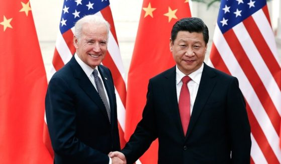 Chinese President Xi Jinping, right, shakes hands with then-Vice President Joe Biden inside the Great Hall of the People on Dec. 4, 2013, in Beijing, China.