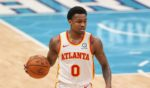 Atlanta Hawks guard Brandon Goodwin brings the ball up court against the Charlotte Hornets in the first half of an NBA basketball game in Charlotte, North Carolina, on April 11, 2021.