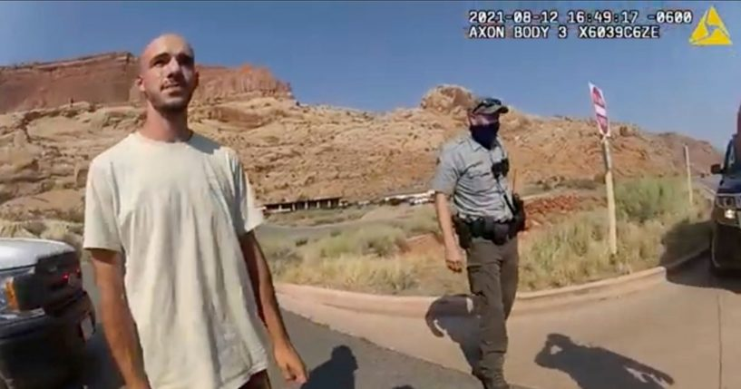 """This Aug. 12, 2021 file photo from video provided by the Moab, Utah, Police Department shows Brian Laundrie talking to a police officer after police pulled over the van he was traveling in with his girlfriend, Gabrielle """"Gabby"""" Petito, near the entrance to Arches National Park in Utah."""