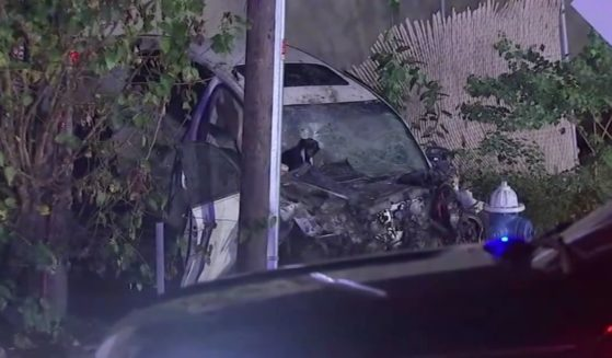 The scene of a car crash is shown, after a 17-year-old valet at Cafe Mawal in Houston reportedly took a customer's car out for a joyride.
