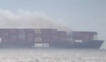 A fire is seen on board the Zim Kingston off of the coast of Washington on Saturday.
