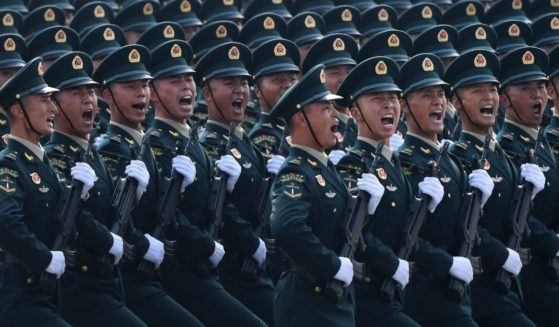 Chinese troops march in a military parade in Tiananmen Square in Beijing on Oct. 1, 2019.